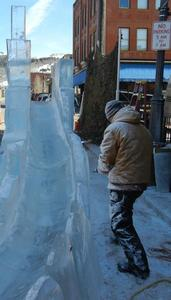 Ted Struckman of Struckman Sculpture Ice, carving an ice slide at a Colorado Winter Festival.